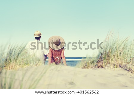 Couple Sitting Comfortable Beach Grass Holiday Concept - stock photo