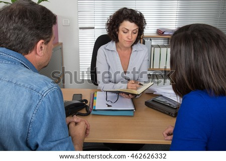 Couple sitting in meeting making investment or takes credit.