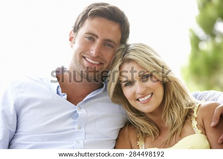 Couple Sitting On Outdoor Seat Together