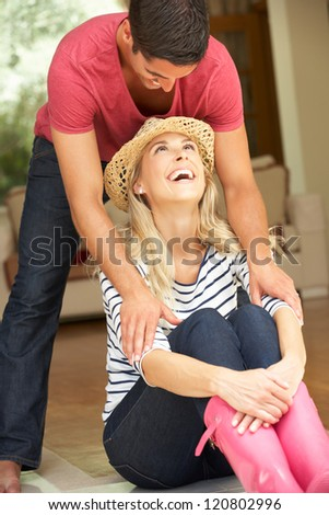 Couple Sitting Outside House - stock photo