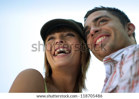 Couple smiling in the sunshine