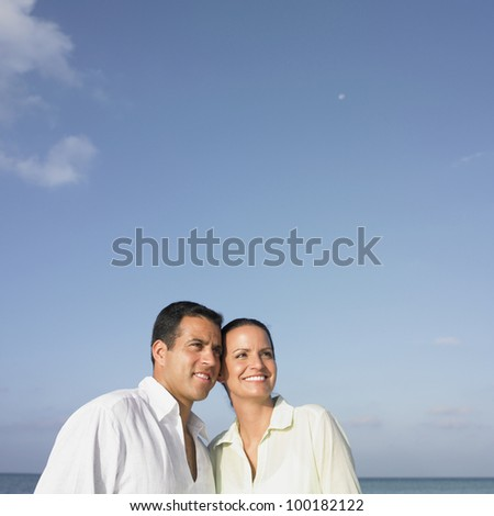 Couple smiling together - stock photo