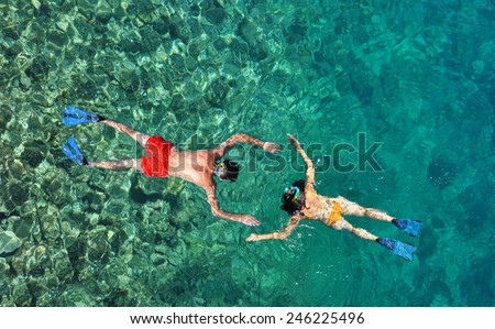 Couple snorkeling at Phi Phi Island, Phuket, Thailand - stock photo