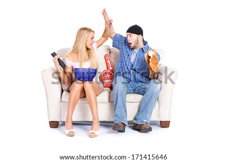Couple: Sports Fans High Five During Game - stock photo