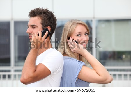 Couple standing outside with mobile phone