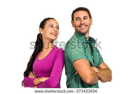 Couple standing with arms crossed on white background