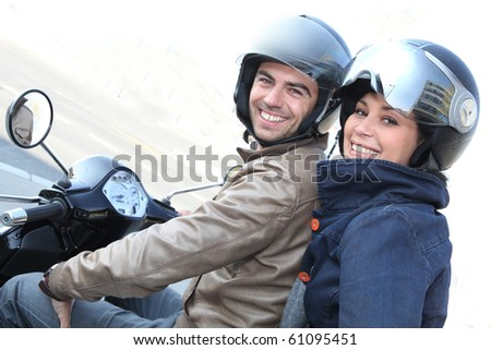 Couple strolling on motorcycle - stock photo