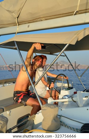 Couple take a selfie photos during sailing in the yacht - stock photo