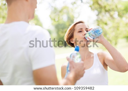 Couple taking a break from exercises - stock photo