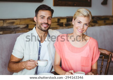 Couple taking a cup of coffee at the cafe