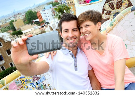 Couple taking picture of themselves in Guell park - stock photo