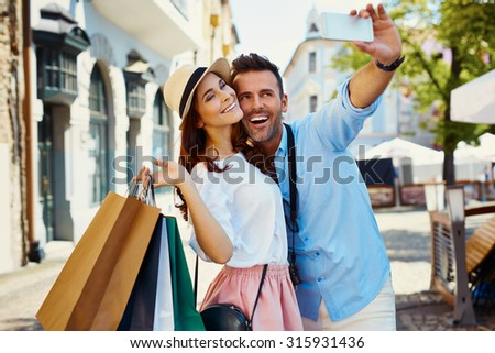 Couple taking selfie in the city - stock photo