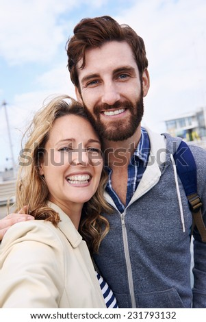 Couple taking selfie on vacation  - stock photo