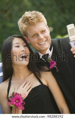 Couple Taking Their Own Photo with Cell Phone Camera - stock photo