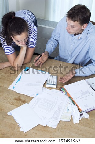 Couple talking about debt and financial problems - stock photo