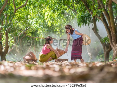 Couple Thai lady in traditional style costume. Happy smile and enjoy in lifestyle during morning time.