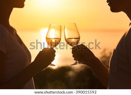 Couple toasting in a beautiful setting.  - stock photo
