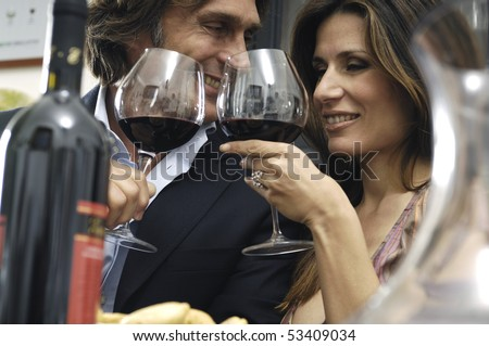 couple toasting in a restaurant - stock photo