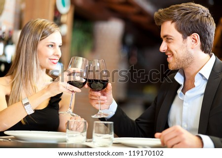 Couple toasting wine glasses - stock photo