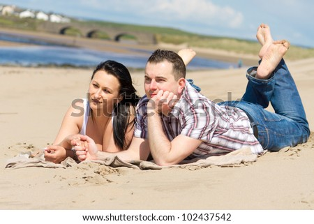 Couple together at relaxation on the beach - stock photo