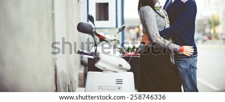 Couple together at street holding hands.  - stock photo