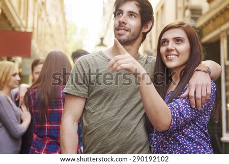 Couple touring the city in the summer