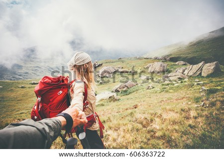 http://thumb9.shutterstock.com/display_pic_with_logo/919514/606363722/stock-photo-couple-travelers-man-and-woman-follow-holding-hands-at-foggy-mountains-landscape-on-background-love-606363722.jpg