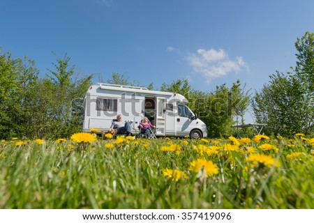 Couple traveling by mobil home - stock photo