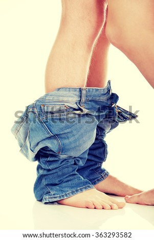 Couple undressing each other. - stock photo