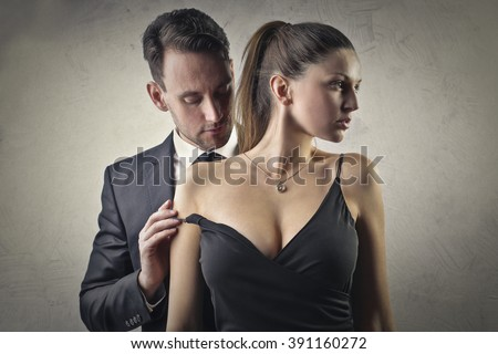 Couple undressing one another - stock photo