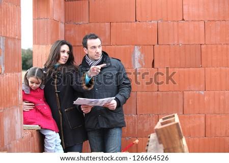 Couple visiting unfinished house - stock photo