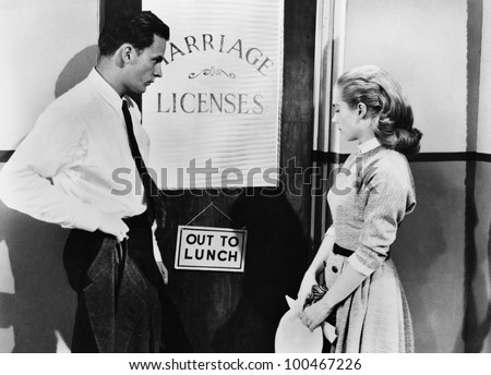 Couple waiting outside marriage license office - stock photo