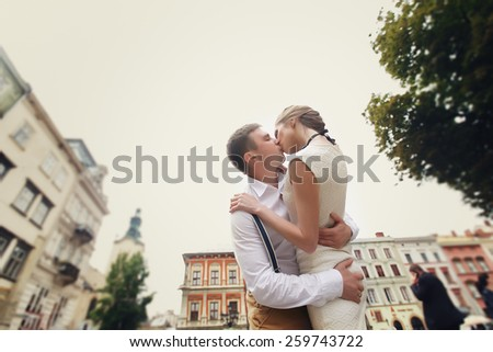 couple walk in old town lvov,kissing,loving