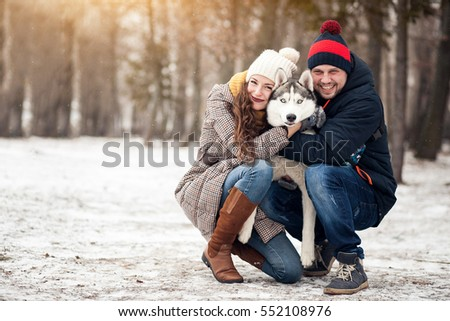 couple walking dog winter