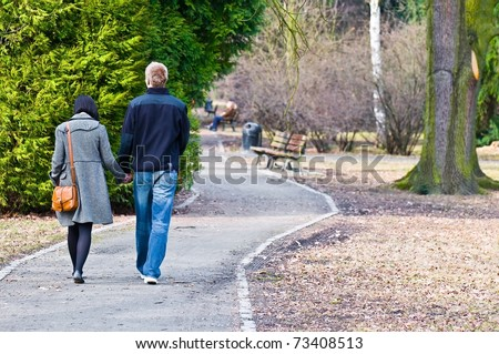 Couple walking down the park