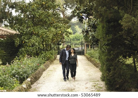 Couple walking in a villa - stock photo