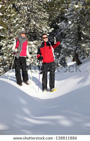 Couple walking in the snow - stock photo