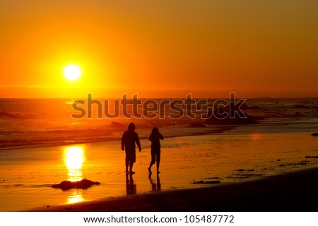 couple walking into the sunset