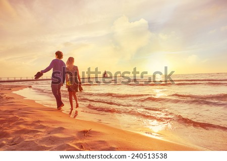 Couple Walking On The Beach At Sunset Heart Shaped Cloud In Sky Instagram Filter