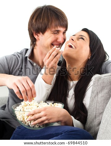 couple watching a film on white background - stock photo
