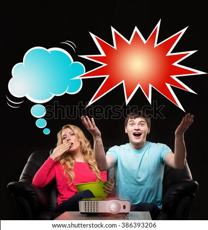 Couple watching a sport event on a laser projector. Husband being emotional while wife being bored. Comics concept. - stock photo