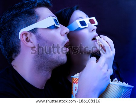 couple watching action movie in cinema - stock photo
