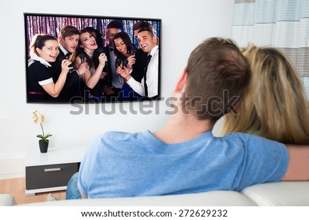 Couple Watching Movie On Television At Home - stock photo