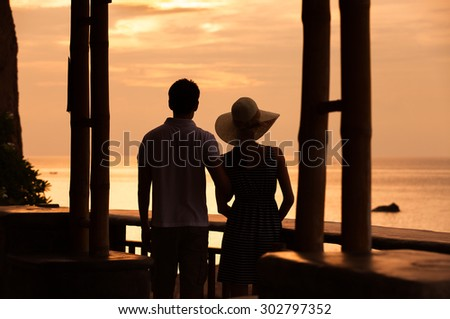 Couple watching the sunset.  - stock photo