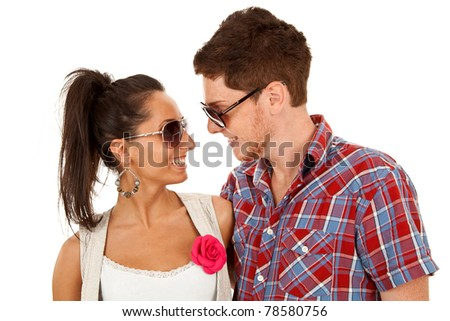 couple wearing sunglasses and standing face to face - stock photo