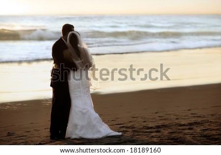 Couple wedding on the beach at sunset