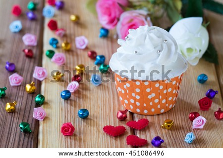 Couple Wedding rings on cup cake. Wedding symbols, attributes. Holiday, celebration. with blur couple heart and flowers