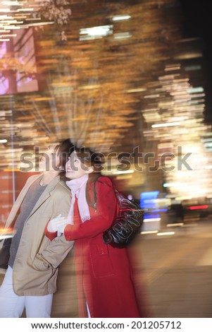 Couple who walks the town while his arms folded - stock photo