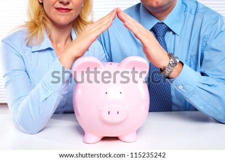 Couple with a piggy bank. Saving money. - stock photo