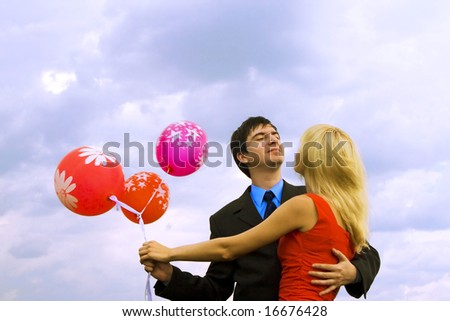 Couple with balloons - stock photo